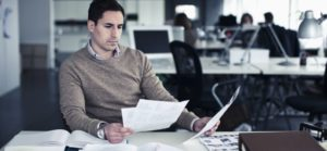 sales recruiter reading resume