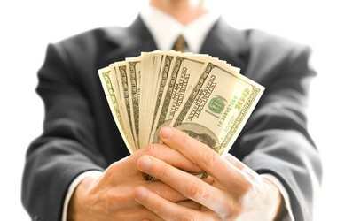 Sales Person Holding Money